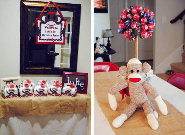 A sign from Quax welcomes guests to the party and gable boxes filled with party favors are displayed beneath. The Tootsie Pop tree centerpiece is homemade ... & Sock monkey party: Luke is 1! | Chickabug