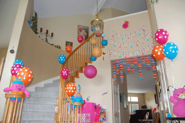 ... banner , and homemade party poms, streamers, and monster dolls