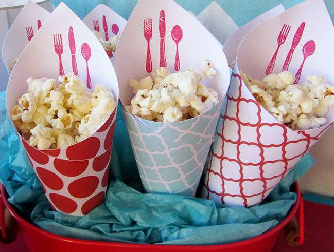 Party food idea: Serve popcorn in cones made from pretty scrapbook papers