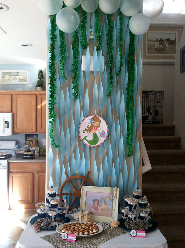 Blue paper streamers and green ruffled streamers serve as a sea-worthy ...