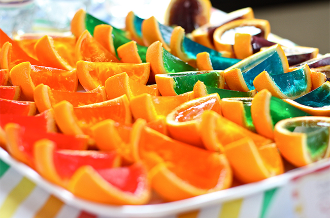 A gorgeous rainbow birthday party! - Orange jello slices in every color of the rainbow
