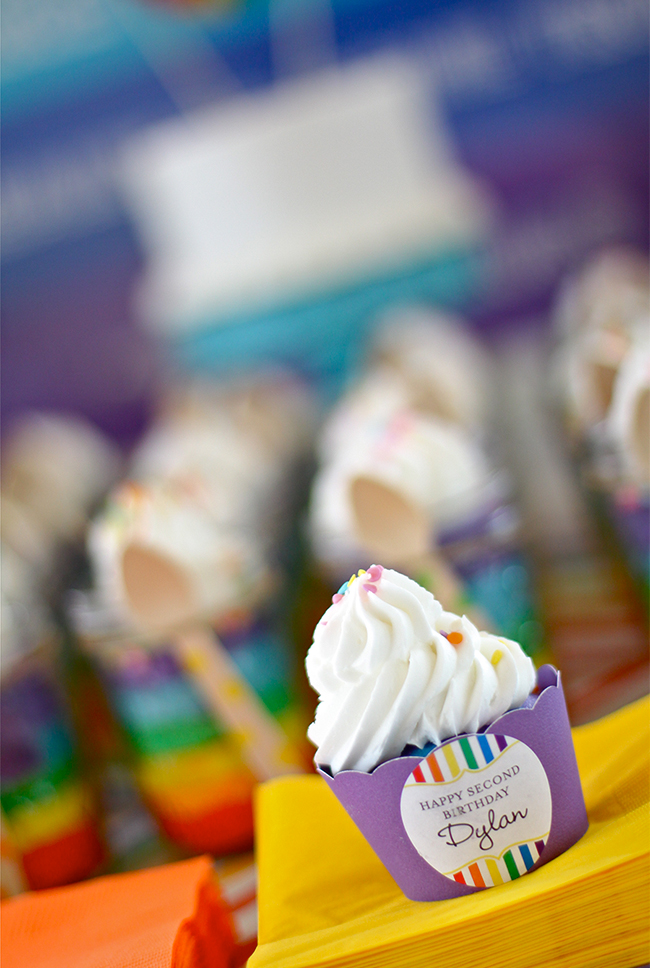 A gorgeous rainbow birthday party! - Cupcakes with wrappers from Your Little Cupcake and stickers from Chickabug