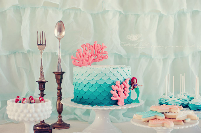 Aqua ruffled backdrop hints at the sea and the neutral fabric and lace