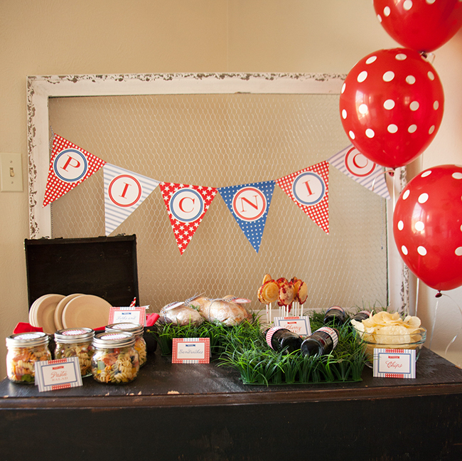 Patriotic picnic held indoors! So fun for a rainy summer day. Printables from Chickabug