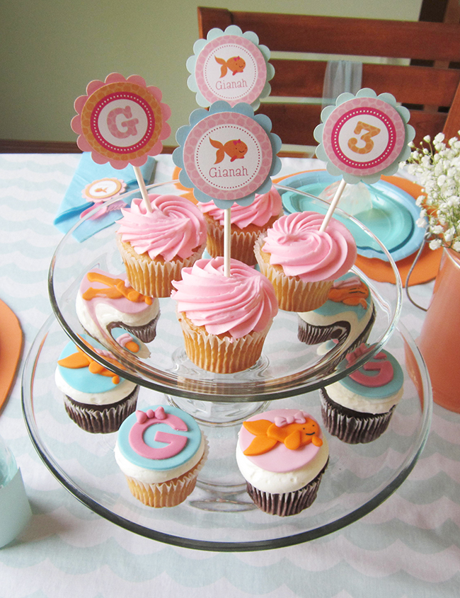 Pink goldfish birthday party with printables from Chickabug