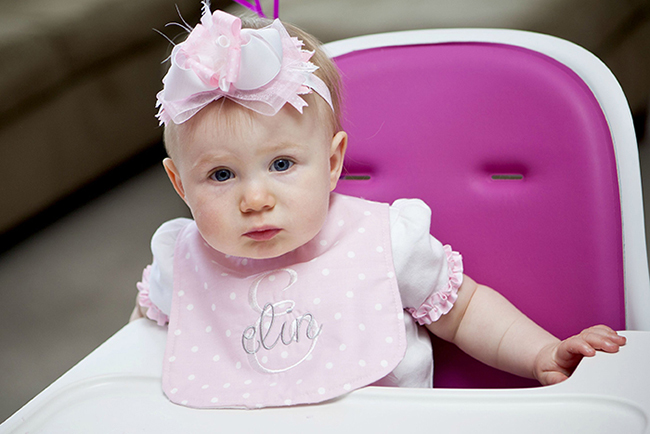 "Gorgeous ""Pretty in Pink"" first birthday party - custom bib from Dainty Couture and bow from Chic Bella Bowtique"