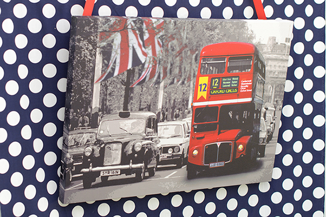 """London Calling"" 2nd birthday party - fabric backdrop with a photo centerpiece"
