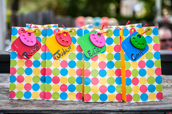 Pop art theme birthday party - colorful favor bags with art palette crayons