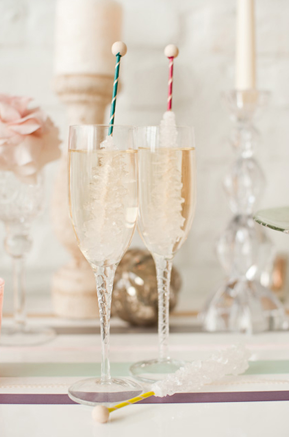 Champagne with rock candy swizzle sticks - great idea for New Year's!