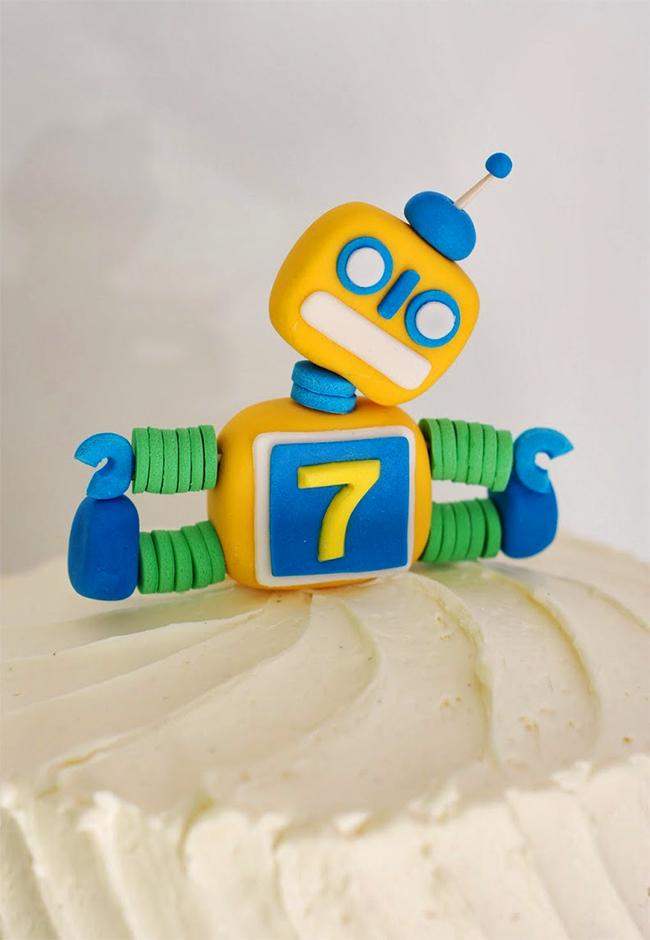 Adorable robot cake topper