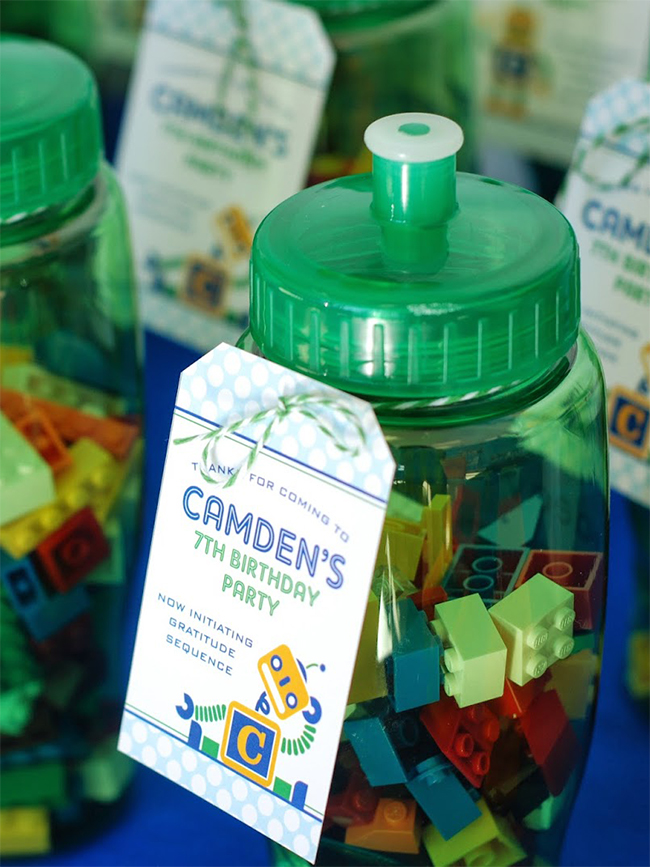 Easy robot party favors - LEGOs in a water bottle with a printable favor tag from Chickabug