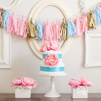 Pretty baby shower! Flowered diaper cake and DIY tassel garland