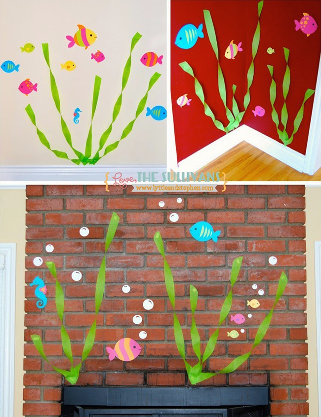 On the walls streamer seaweed fish and bubbles add to the