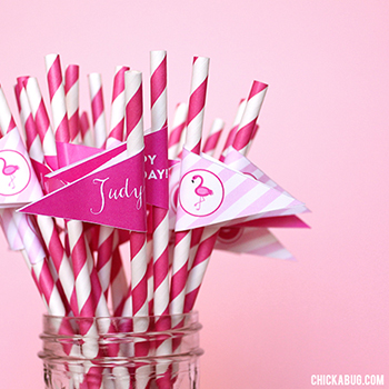 Fun straws with personalized flags for a pink flamingo party!