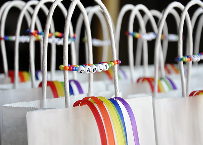 Rainbow party favor bags and bracelets