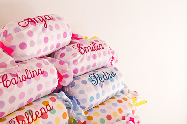 A sweet party favor - candy-shaped pillows, embroidered with each child's name