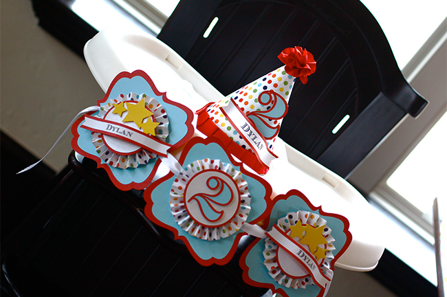 A gorgeous rainbow theme high chair banner and party hat - from Party Nest Designs