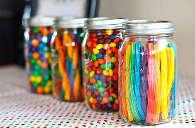 Rainbow theme candy bar - so cute to put the candy in mason jars!