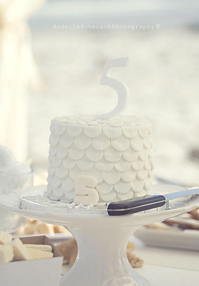 Gorgeous beach birthday party - white ruffle cake