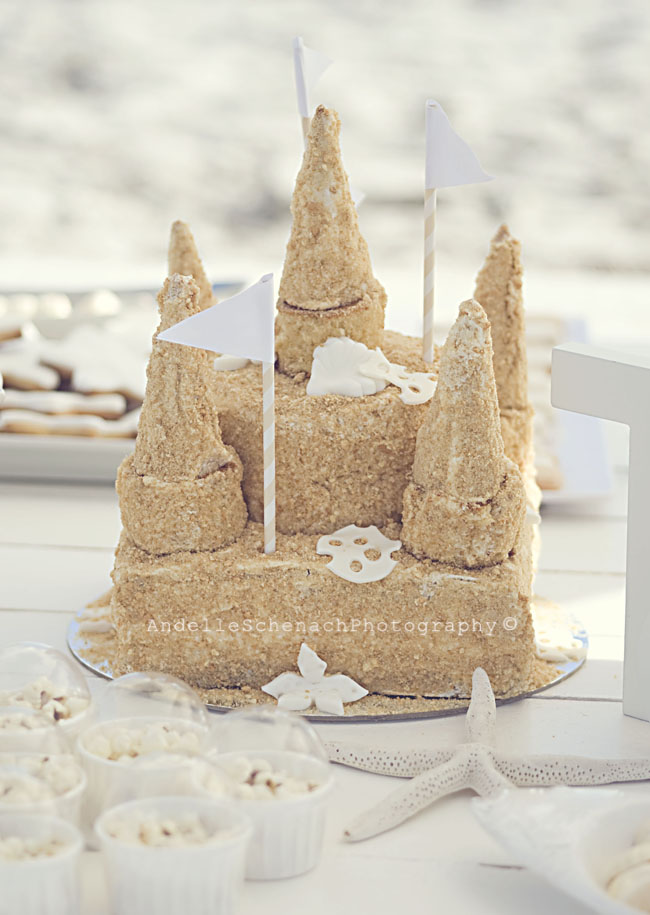 Gorgeous beach birthday party - sand castle cake