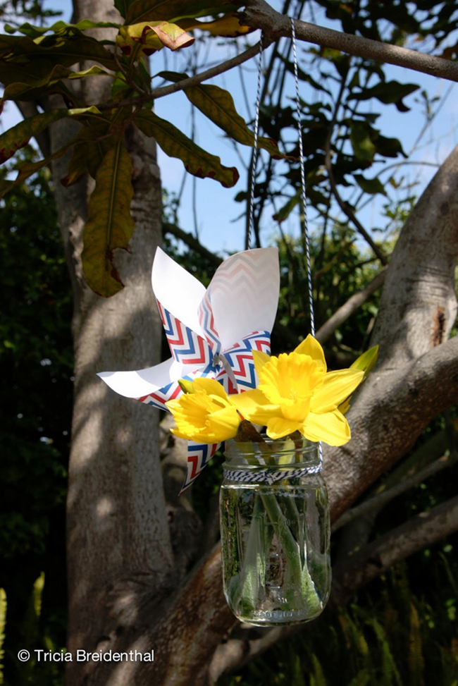 Mason jars with pinwheels and daffodils