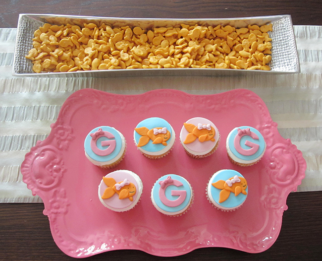Pink goldfish fondant cupcake toppers by Sugar and Stripes Co.