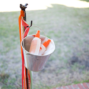 Bug spray station - awesome idea for an outdoor summer party!