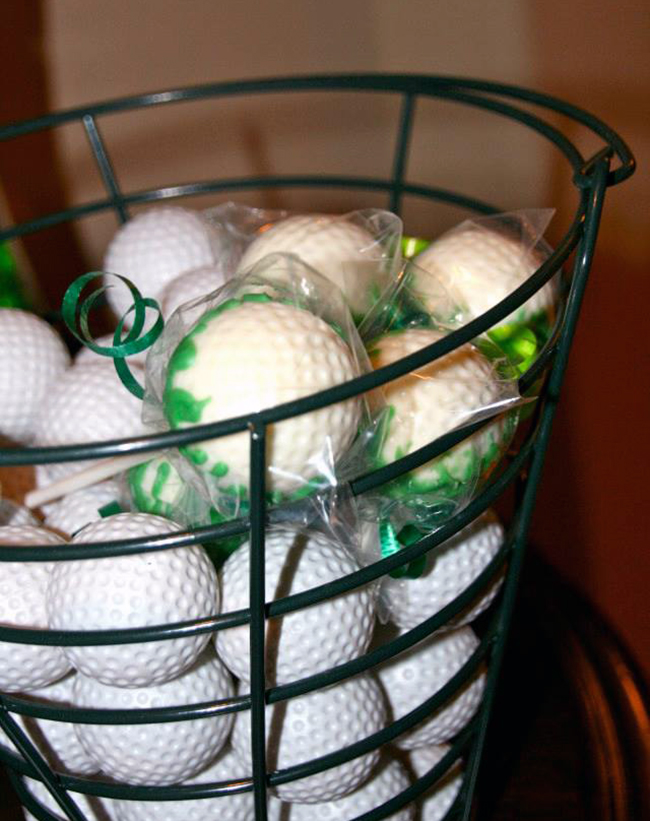 Chocolate-dipped golf ball cake pops
