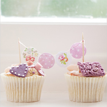 Purple cupcakes with bunting