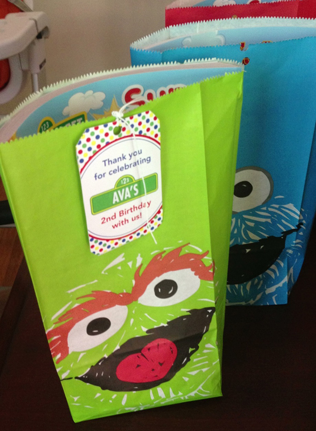 Sesame Street birthday party! Party favor bags from Zulily.com with printable tags from Chickabug.com