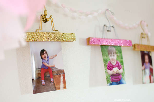 Glittered hanger photo display for a birthday party