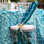 Beautiful mermaid party chair and ruffled tablecloth