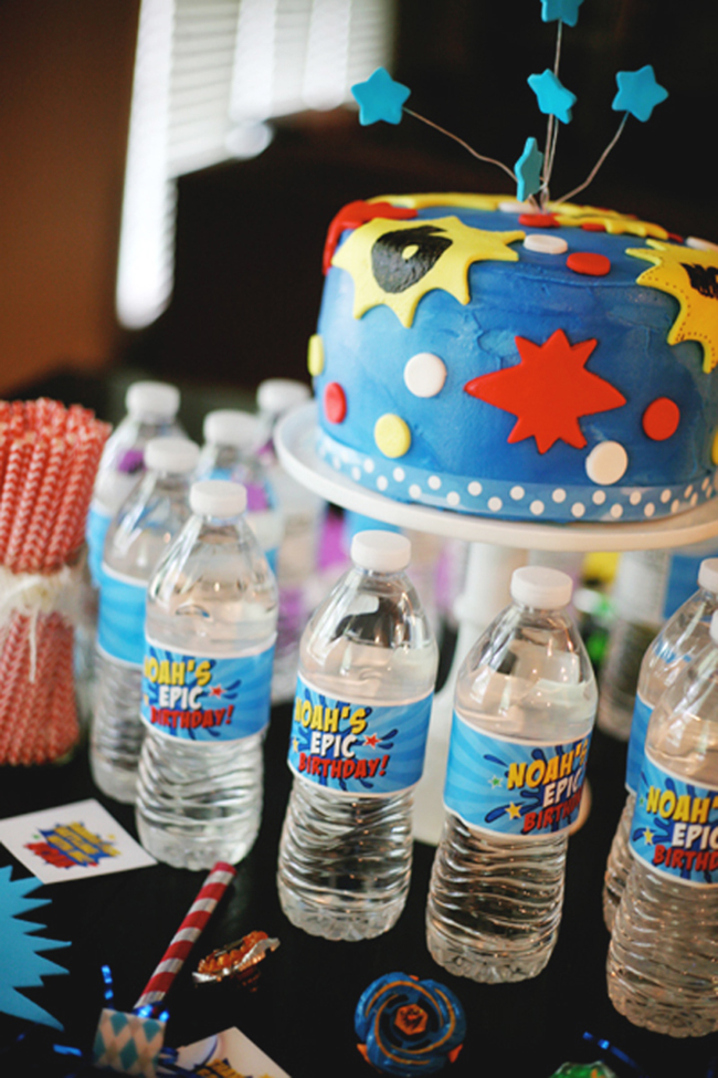 Superhero birthday cake made with a kit Ella Vanilla, www.ellavanillacakekits.com, and water bottle labels from Chickabug, www.chickabug.com