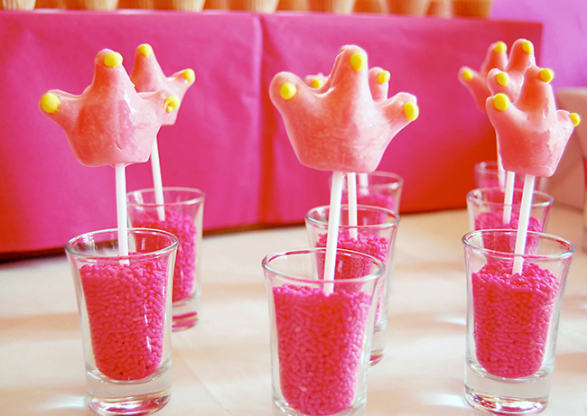 Princess theme birthday party - pink crown lollipops in pink sprinkle shooters