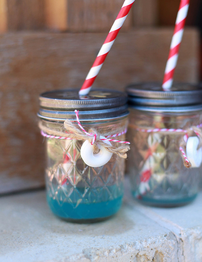 "Nautical theme birthday party - ""sea water"" in mason jars with daisy cut lids and vintage straws"