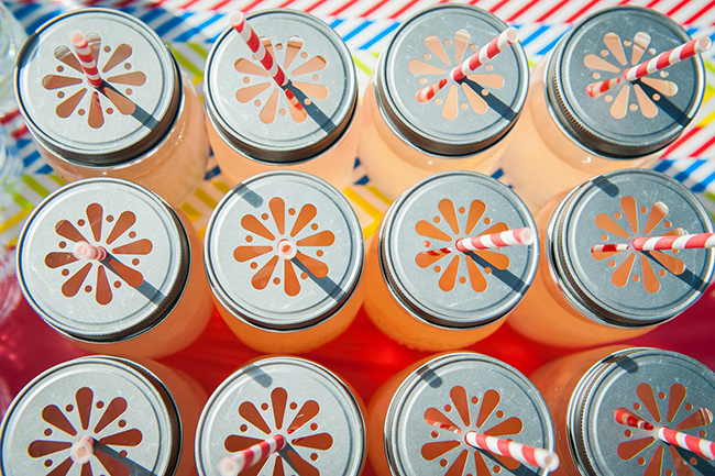 Pop art theme birthday party - mason jar drinks with daisy cut pewter lids