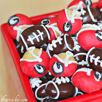 Football and football helmet chocolate covered nuts - SO perfect for a tailgate, football theme party, or the Super Bowl!