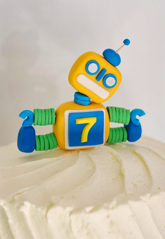 Adorable robot cake topper