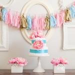 Pretty baby shower! Flowered diaper cake and DIY tassel garland