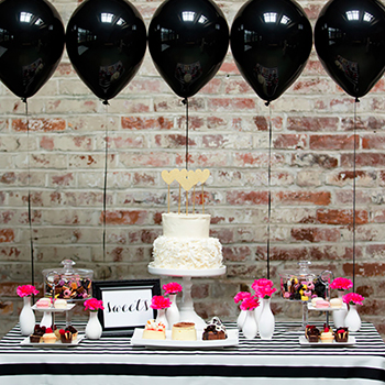 Pink and black dessert table